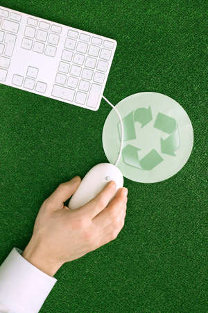 mouse pad: Person using computer mouse mouse pad with recycling symbol elevated view