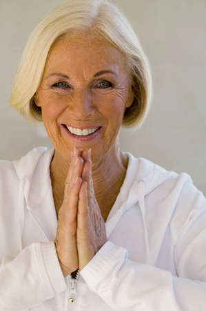 zest for life: Senior woman meditating smiling closeup portrait LANG_EVOIMAGES