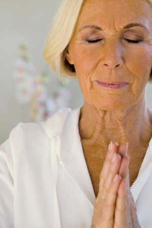 Senior woman meditating smiling