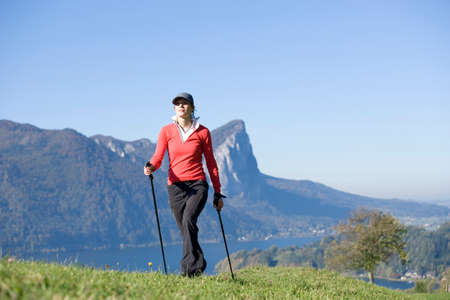 nordic walking: Woman exercising Nordic Walking Austria alps