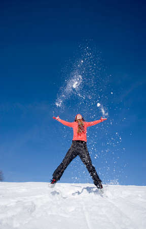 zest for life: Woman jumping in snow