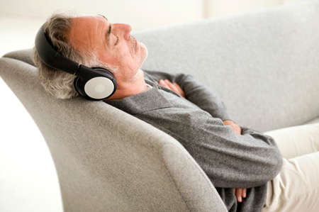 only senior adults: Mature man wearing headphones eyes closed elevated view
