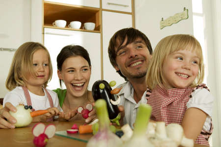 familiy: Familiy in kitchen playing with children LANG_EVOIMAGES