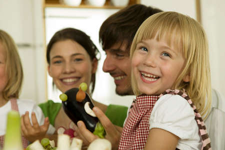 tinkering: Parents with children 45 playing in kitchen smiling