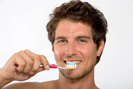 adult brushing teeth: Young man holding tooth brush portrait