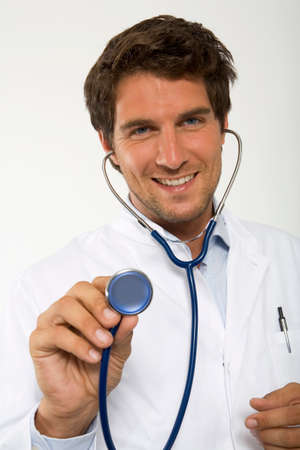 auscultate: Male doctor holding stethoscope closeup portrait