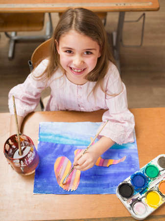 elevated view: Girl 47 painting smiling elevated view portrait LANG_EVOIMAGES