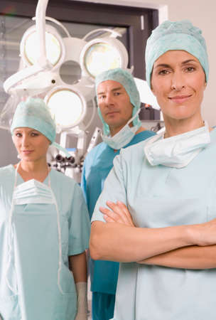 surgical nurse: Female surgeon surgeon and surgical nurse in the operating room