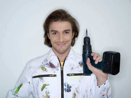 electric drill: Man holding electric drill portrait LANG_EVOIMAGES