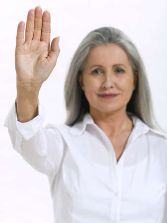 only senior adults: Senior woman showing palm