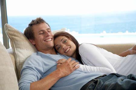 adulthood: Couple relaxing on sofa