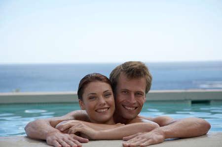 adulthood: Couple in swimmingpool portrait