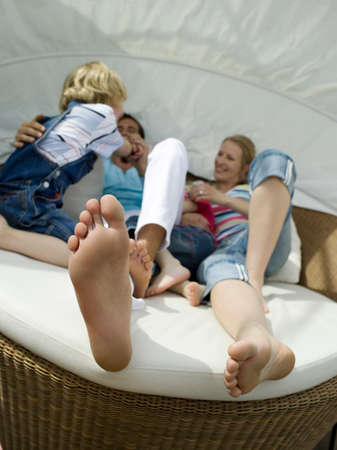 out of doors: Familiy on sofa out doors