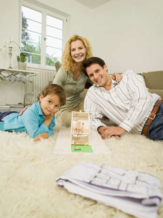 family  room: Young family in living room