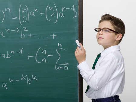 Prodigy: Boy 10-11 standing in front of blackboard portrait