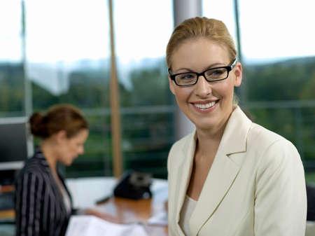 Businesswomen in office smiling