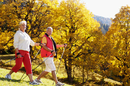 nordic walking: Senior couple nordic walking outdoors