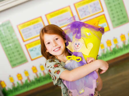 learning series: Girl holding schoolcone