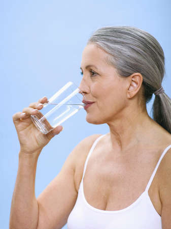 only senior adults: Senior woman drinking water portrait