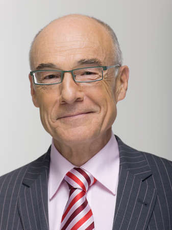 only senior adults: Senior businessman portrait smiling