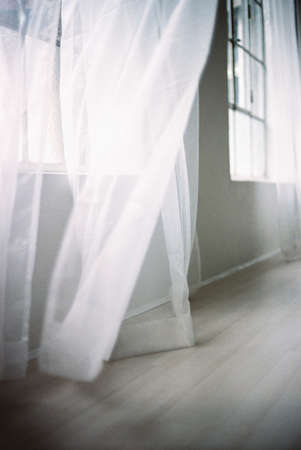 curtain window: Blowing white curtain LANG_EVOIMAGES