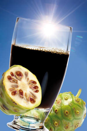 Glass of noni juice fresh fruits LANG_EVOIMAGES