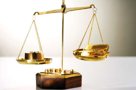 gold bar: Gold bar on a a pair of scales