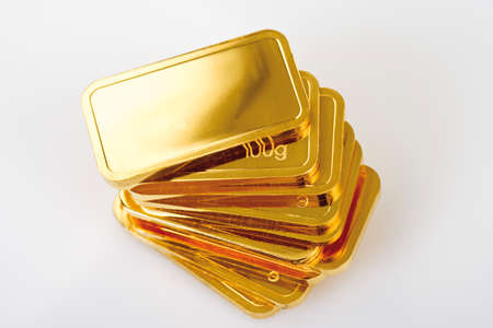 medium group of objects: Gold bars on white background elevated view