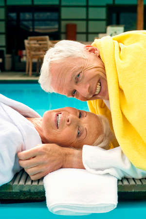 bath towel man: Germany Senior Couple Relaxing on jetty