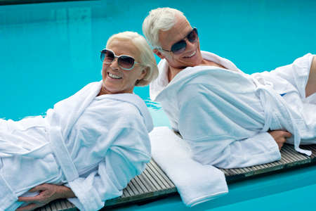 bath towel man: Germany Senior Couple relaxing LANG_EVOIMAGES