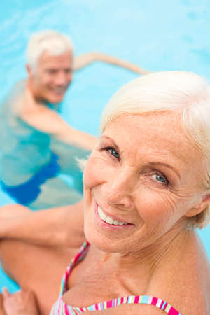 zest for life: Germany Senior couple in swimming pool