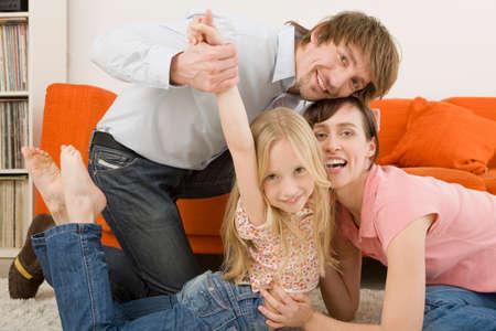 family  room: Playful family in living room