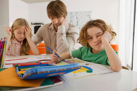 overstress: Father and children doing homework