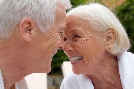 zest for life: Germany senior couple face to face portrait LANG_EVOIMAGES