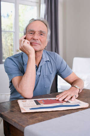 only senior adults: Senior man sitting at table portrait