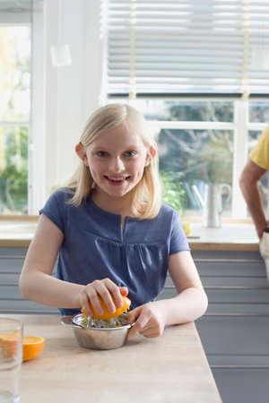 juice squeezer: Girl 89 preparing fresh orange juice smiling portrait