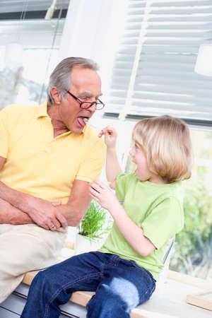 grandson: Grandson 89 feeding grandfather