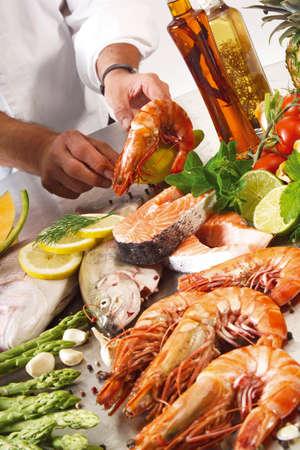 unrecognisable person: various  Sea fruits LANG_EVOIMAGES