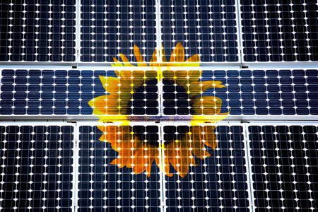 energies: Sun flower behind solar cells LANG_EVOIMAGES