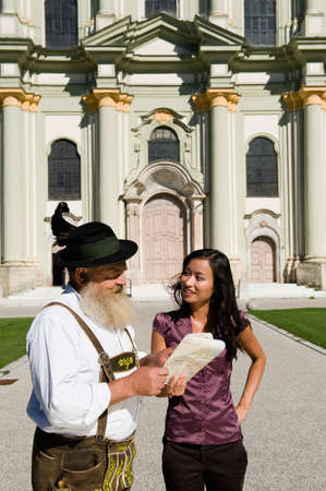 helpfulness: Germany Bavaria Upper Bavaria Asian woman and old Bavarian man looking at map