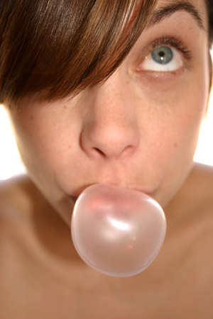 chewing: Woman doing chewing gum bubble