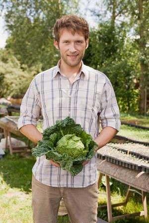 savoy: Man holding savoy cabbage portrait