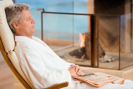 only senior adults: Man in a bathrobe eyes closed sleeping portrait