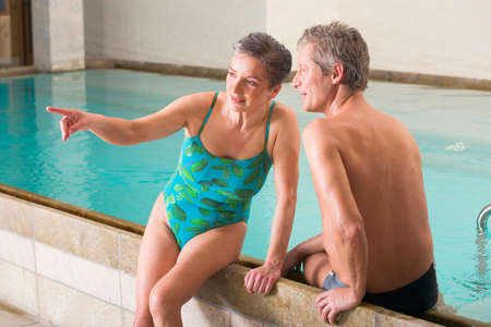 swimsuits: Mature couple in swimming pool portrait