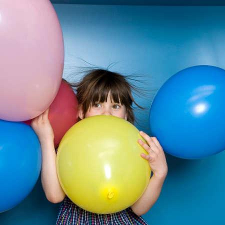 only girls: Girl 67 holding balloons portrait LANG_EVOIMAGES
