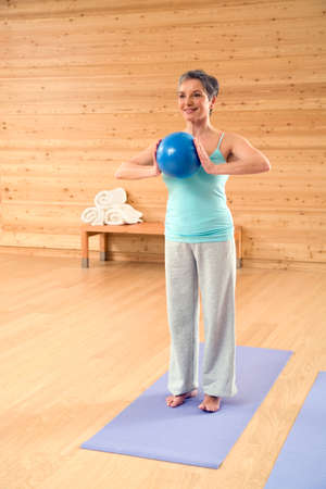 only senior adults: Mature woman with gymnastic ball portrait