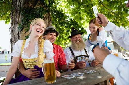 beer garden: Germany Bavaria Upper Bavaria People playing cards in beer garden