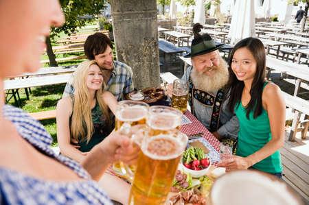beer garden: Germany Bavaria Upper Bavaria People in beer garden having cold snack