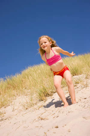 Germany Baltic sea Girl 67 jumping down sand dunes LANG_EVOIMAGES