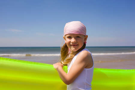 Germany Baltic sea Girl 67  holding airbed portrait